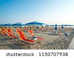 umbrellas and chaise lounges on ... | Shutterstock . vector #1150707938