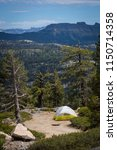 campers set up a nylon tent at...   Shutterstock . vector #1150714358