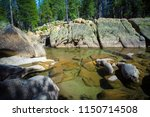 this rocky stream is a roadside ... | Shutterstock . vector #1150714508
