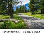 paved walkway and sierra trees... | Shutterstock . vector #1150714565