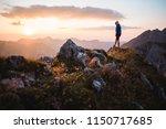 hiker girl enjoying a sunset on ...   Shutterstock . vector #1150717685