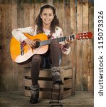 young girl playing the guitar - stock photo