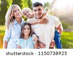 beautiful smiling lovely family ... | Shutterstock . vector #1150738925