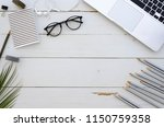 artist workspace with laptop ... | Shutterstock . vector #1150759358