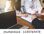 broker giving keys of new house ... | Shutterstock . vector #1150765478
