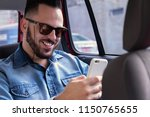 happy young bearded man wearing ... | Shutterstock . vector #1150765655