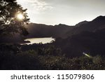 Mountain landscape with sun light glowing - stock photo