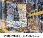 drone photo of construction site. tower cranes and industrial machinery for building construction - stock photo