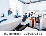 hair washer in hair saloon.... | Shutterstock . vector #1150871678