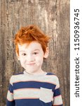 red haired boy with disheveled... | Shutterstock . vector #1150936745
