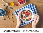 eating healthy breakfast.... | Shutterstock . vector #1150964852