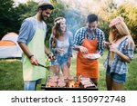 friends spending time in nature ... | Shutterstock . vector #1150972748