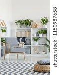 pouf on patterned carpet in... | Shutterstock . vector #1150987658