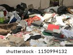 Small photo of dirty rags and abandoned objects in a shed used by illegal immigrants to sleep