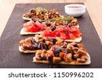 bruschetta with vegetables and... | Shutterstock . vector #1150996202