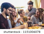 young friends sharing pizza in...   Shutterstock . vector #1151006078