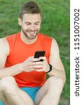 sms concept. happy man write... | Shutterstock . vector #1151007002