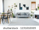 black chairs at table in... | Shutterstock . vector #1151010335