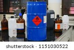 Small photo of Blue color hazardous dangerous chemical drum barrels with red flammable liquid warning label and Variety type of flammable liquid container
