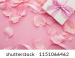 gift box and pink rose petals ... | Shutterstock . vector #1151066462