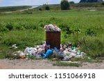 trash on a green summer field | Shutterstock . vector #1151066918
