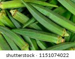 whole raw okra food background | Shutterstock . vector #1151074022