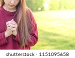 woman praying in the morning on ... | Shutterstock . vector #1151095658