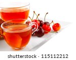 tea and cherry with cakes on... | Shutterstock . vector #115112212
