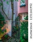 rainbow row street in... | Shutterstock . vector #1151161952