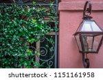 rainbow row street in... | Shutterstock . vector #1151161958
