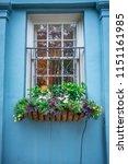 rainbow row street in... | Shutterstock . vector #1151161985
