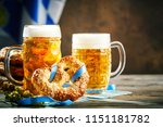 beer mugs and pretzels on a... | Shutterstock . vector #1151181782