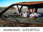 Man Sits In Rusty Car Wreck...