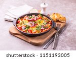 shakshuka with bread toasts in... | Shutterstock . vector #1151193005