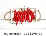 red chilli pepper in the tray... | Shutterstock . vector #1151198432