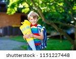 little kid boy with school... | Shutterstock . vector #1151227448