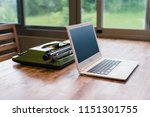 old typewriter and laptop on... | Shutterstock . vector #1151301755