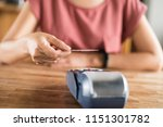 woman using a credit card ... | Shutterstock . vector #1151301782