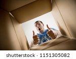 the surprised man unpacking ... | Shutterstock . vector #1151305082