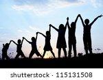 children silhouettes holding...