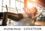 attractive fit woman doing sit... | Shutterstock . vector #1151375108