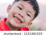 close up of happy kid is... | Shutterstock . vector #1151381525