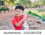 kid boy sit on the iron balcony ... | Shutterstock . vector #1151381528