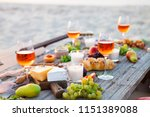 picnic on the beach at sunset...   Shutterstock . vector #1151389088