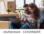 young couple moving in new home.... | Shutterstock . vector #1151446655