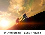 silhouettes of a man helping a... | Shutterstock . vector #1151478365