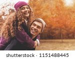 young cute female hugs... | Shutterstock . vector #1151488445
