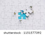 miniature people team trying to ... | Shutterstock . vector #1151577392