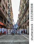 Small photo of PAMPLONA, SPAIN - JUL 11: San Fermin festival revelers crowd the Estafeta corridor on July 11, 2018. Estafeta is a straightaway for the running of the bulls before entering the stadium.