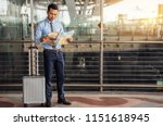 businessman with a suitcase is... | Shutterstock . vector #1151618945